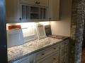 Koch Cabinetry - Bianco Granite Countertop - Berenson Hardware